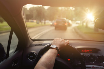 Fototapete - Driving down the street in car on a sunny beautiful day