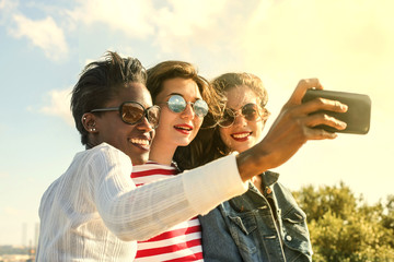 Three girls doing a selfie together