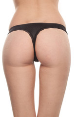 woman with sexy butt, ass in black thong isolated on white background