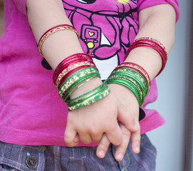 Girl's hands with bracelets