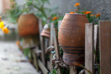 fence clay pot