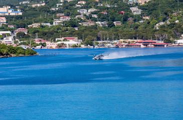 Seaplane Taking Off in Blue Water