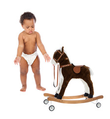 Funny african baby in diaper with a wooden horse