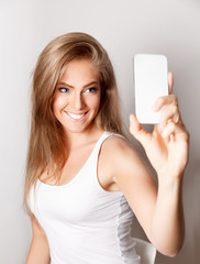 Beautiful happy woman taking a selfie