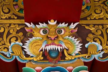 Mythological image of a lion in Buddhist monastery.  India