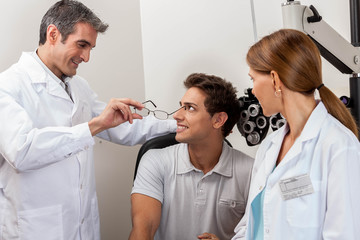 Doctors showing the glasses