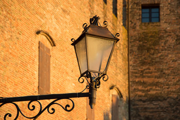 Antique lamp in village Santarcangelo Romagna - travel Italy - closeup