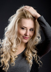 profile of beautiful blonde with curly hair