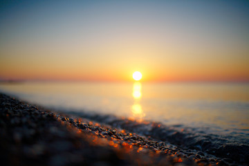 Blurred summer warm sea at dawn in vintage style
