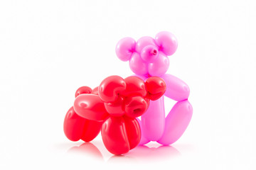 Balloon animal of red pig and pink bear.