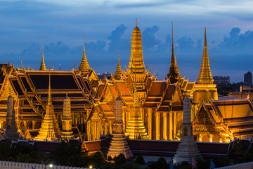 The beauty of the Emerald Buddha Temple at twilight..And while the gold of the temple catching the light. This is an important buddhist temple of thailand and a famous tourist destination.