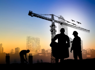 silhouette engineer construction site over Blurred construction