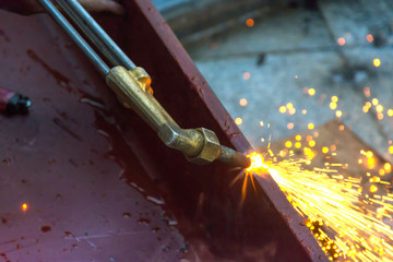 Metal Cutting With Acetylene Gas. Workman is working by use torc