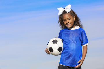 Smiling young african american soccer player portrait with lots of copy space