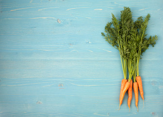 carrots on a blue wooden background