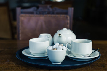 Teapot, cup and sugar on tray