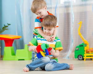 loving children brothers play with educational toys indoors