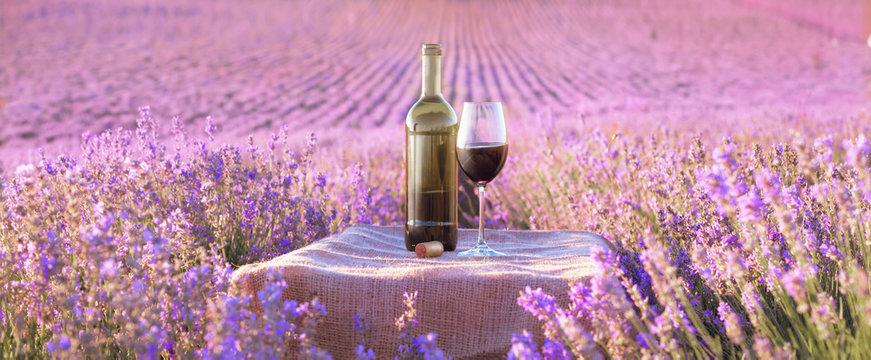 Bottle of wine against lavender.
