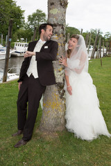 Lovely and young wedding couple happy to be together