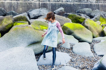 Young woman walking amongst vibrant rocks