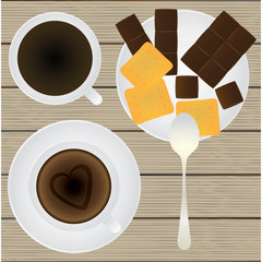 Cup of coffee, saucer, teaspoon, chocolate and cookies on a tabl