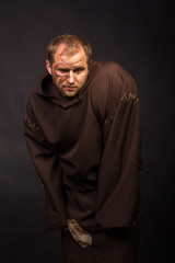 Portrait of the actor in the form of Quasimodo. Theater, stage make-up. Theatrical make-up professionally. Emotional acting.