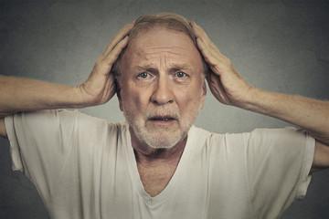 Shocked sad senior man