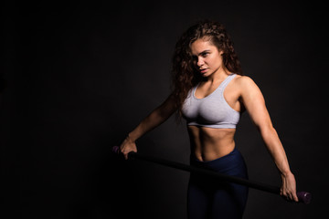 Girl professional athlete. Athletic girl with curly hair. Female sport pauerlifting. Curly athlete.