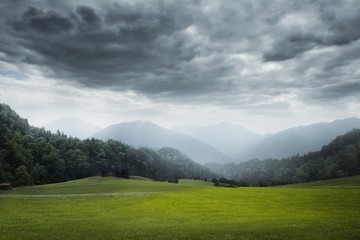 Canvas Prints Dark grey green meadow and cloudy sky