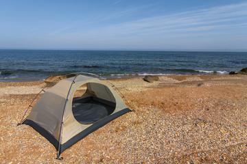 white touristic tent on a sea coast
