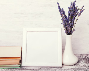 White empty frame with place for text and lavender flowers.
