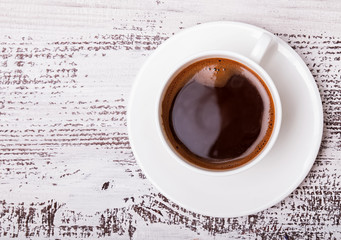 Fotobehang - Cup of coffee on white wooden table