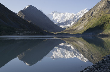 Altai. Morning mountains reflecting in the lake