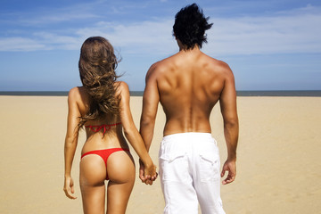 Young sexy couple on the beach
