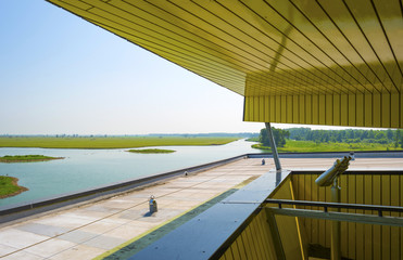 Modern bird hide along a lake in summer