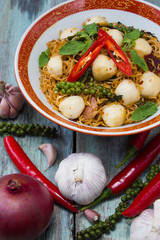 Instant noodle fried with spicy sauce and fish ball