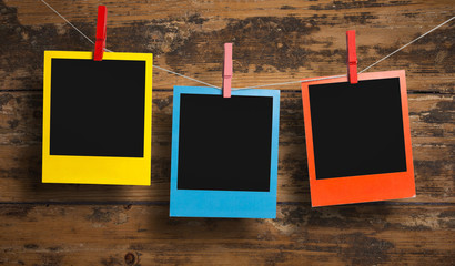 Three color polaroid frames on a clothesline