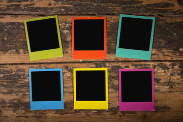 Six color frames on wooden background