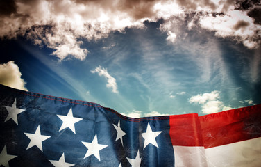 Waving american flag and sky in dark grunge style