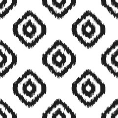Ikat vector seamless pattern. Abstract geometric background for