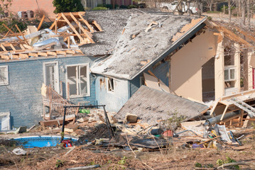 Aftermath of a tornado damaged wood framed house