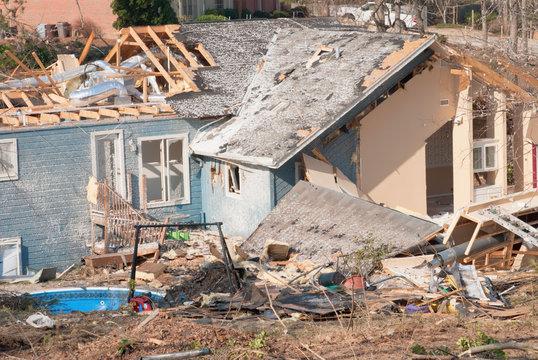 Aftermath of a tornado damaged wood framed house