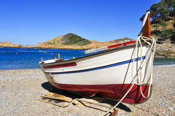 fishing boat stranded on the beach in the Costa Brava, Spain