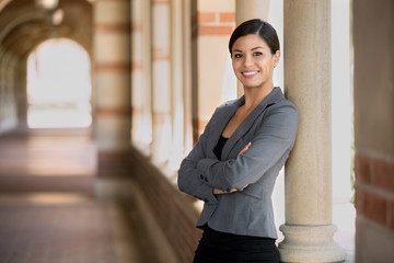 Executive woman management powerful posture standing proud