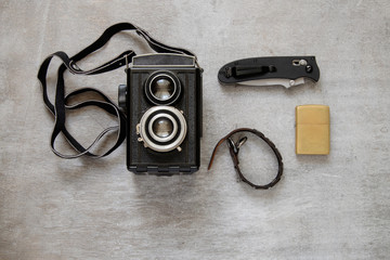 Vintage camera and old razor blade on wooden background