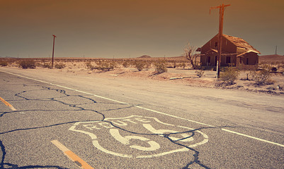 Poster Route 66 Route 66 pavement sign sunrise in California's Mojave desert.