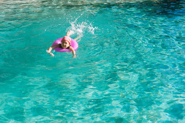 Little girl swim in the pool