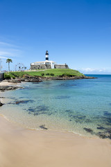 Portrait of the Farol da Barra Salvador Brazil lighthouse from the shallows of the nearby beach