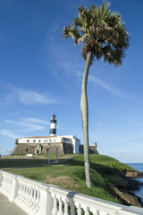 Portrait of the Farol da Barra Salvador Brazil lighthouse from the promenade balcony with palm tree