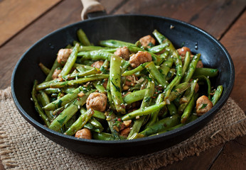 Green beans fried with chicken meatballs and garlic Asian style